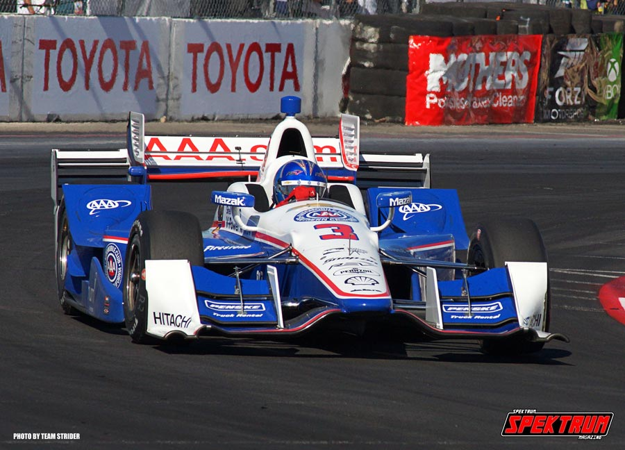 Driver Helio Castroneves taking his AAA Indy Car through the corners