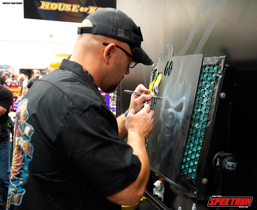 Artist airbrushing one really nice piece of work at the House of Kolor booth