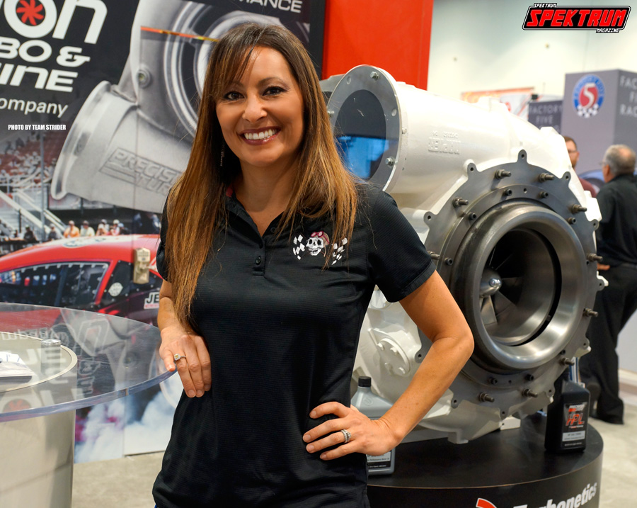 Driver Tina Pierce posing with the massive Turbonetics turbo
