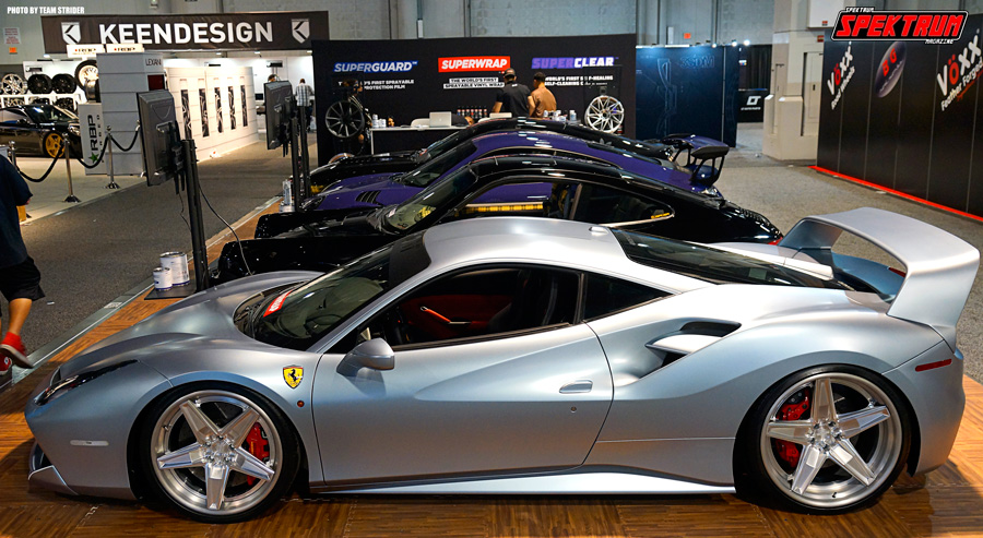 A line of supercars in the Wheels & Tires Hall at SEMA